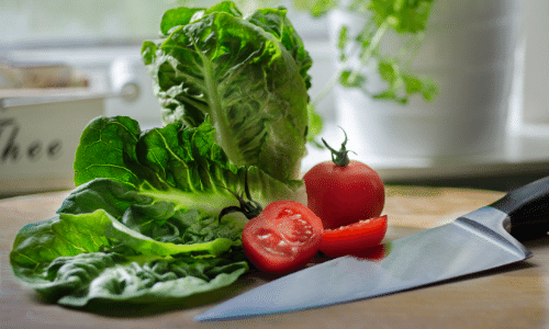 Chef knife with lettuce and tomato